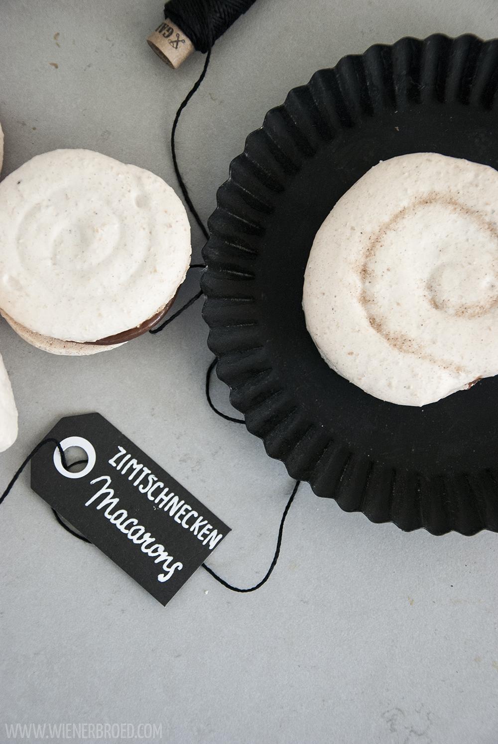 Zimtschnecken-Macaron-Schnecken, das typisch nordische Gebäck in feinem französischen Klein [wienerbroed.com] Cinnamon bun macarons